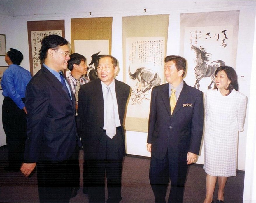 Me, showing around my Chinese horse paintings  to the VIPs.