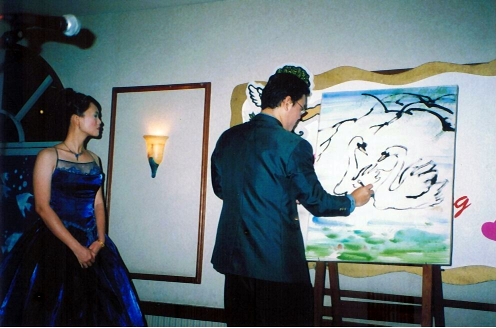 I painted a couple of loving swans expressing my love to my wife on the spot of the wedding ceremony.