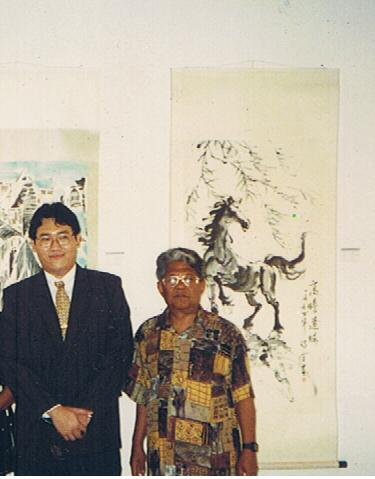 From left: Datuk Harun Din, Director General of Election Commission Malaysia and I pictured in front of one of my horse paintings displayed at the art show.