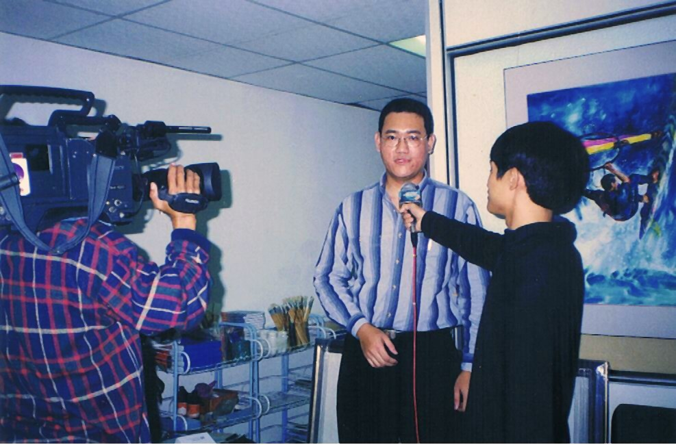 Me, in front of the camera man, being interviewed by TV reporter.