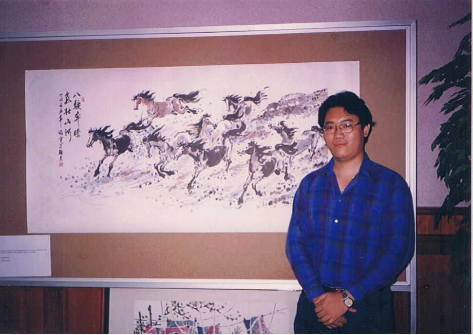 Me, in front of one of my horse paintings during the art exhibition.