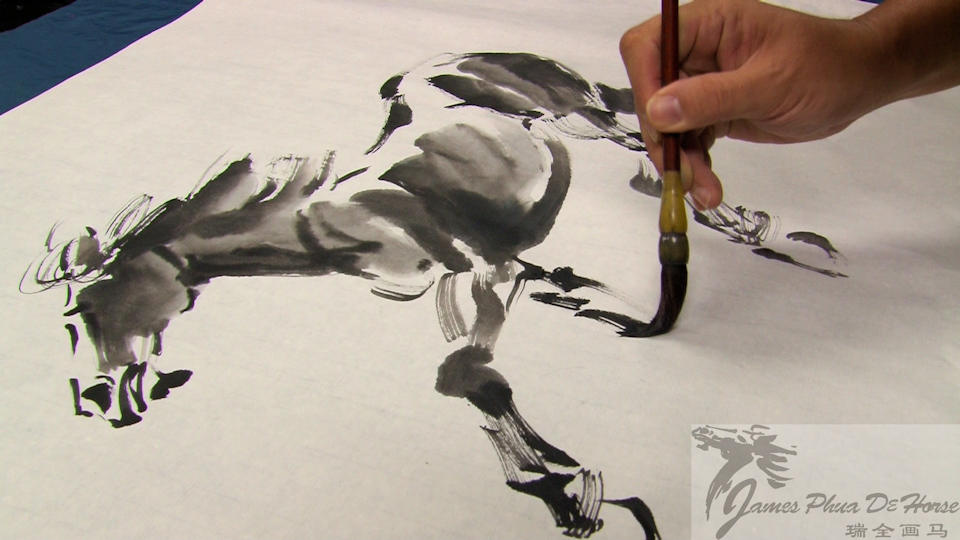 James Phua is drawing a Chinese horse painting