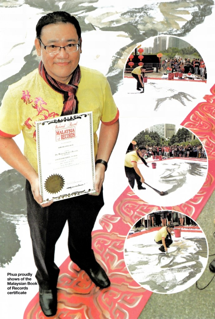 Phua proudly shows of the Malaysian Book of Records Certificate.