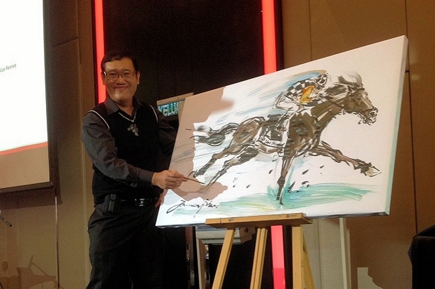 James at the final master touch of his horse racing painting at the Melbourne Cup Luncheon 2013 organized by MANZA (The Malaysian Australian New Zealand Association).