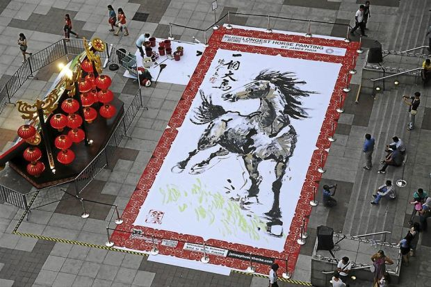 Impressive: The longest Chinese horse painting was created and unveiled at Suria KLCC in conjunction with the Chinese New Year celebration.