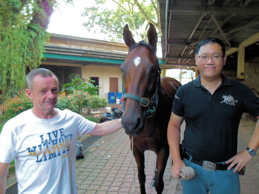 I get closed to one of racehorses in Richard's (left) stable at Selangor Turf Club Malaysia.