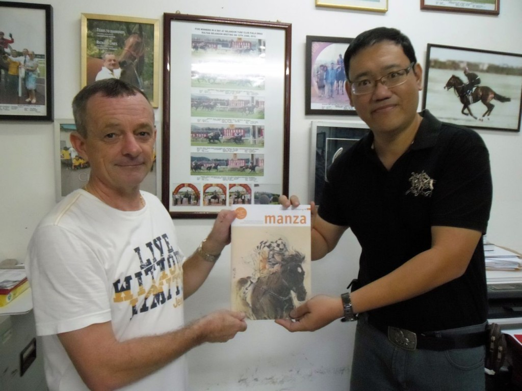 Richard Lines receiving a souvenir from me, MANZA Magazine January 2014 with my horse painting as its front cover. I depicted 'So You Think', one of the best horses in Australian racing history.