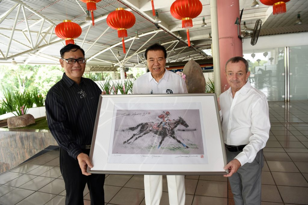Handover of Limited art print: Taichi Master. From Left: James Phua, Tan Seri Datuk Richard Cham (Chairman of STC), Richard Lines (the horse trainer)