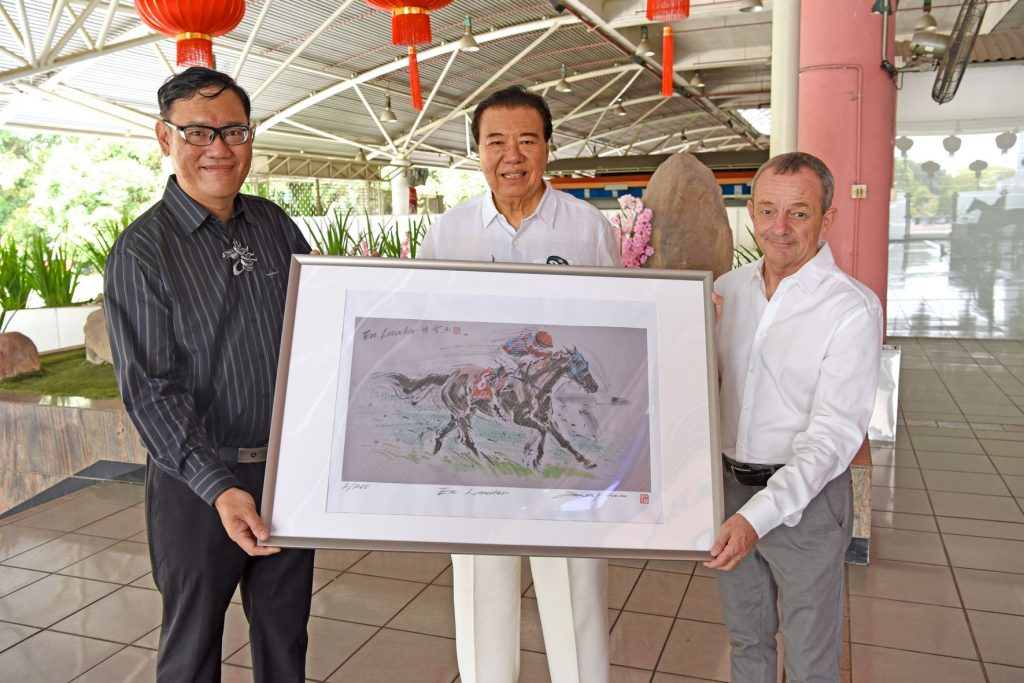 Handover of Limited art print: En Lauder From Left: James Phua, Tan Seri Datuk Richard Cham (Chairman of STC), Richard Lines (the horse trainer)