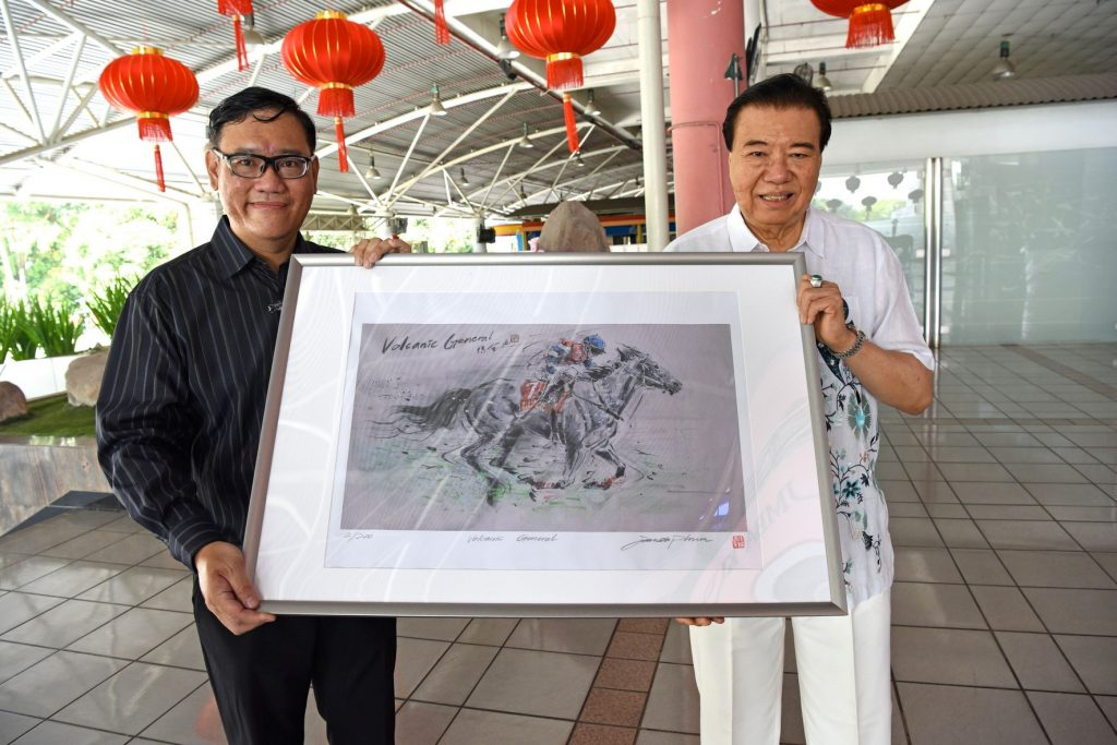 Handover of Limited art print: Volcanic General  From Left: James Phua, Tan Seri Datuk Richard Cham (Chairman of STC)