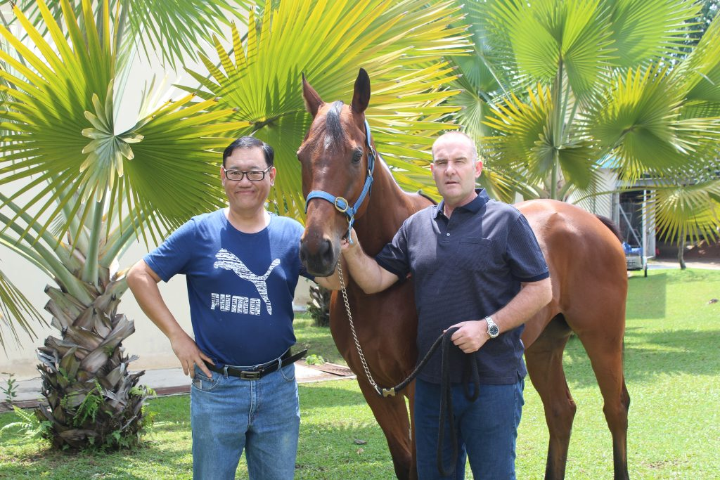 Mr.Armstrong, one of STC famous racehorses (left: James Phua, right: Frank Maynard, horse trainer)